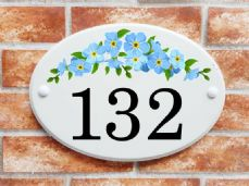 Blue floral spray house sign